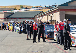 June 22, 2018 - Sonoma, CA, U.S. - SONOMA, CA - JUNE 22: Race crews line up with their cars for inspection on Friday, June 22, 2018 at the Toyota/Save Mart 350 Practice day at Sonoma Raceway, Sonoma, CA (Photo by Douglas Stringer/Icon Sportswire) (Credit Image: © Douglas Stringer/Icon SMI via ZUMA Press)