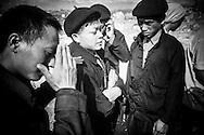 A group of Hmong men argue near the Dong Van town market in Ha Giang Province, northern Vietnam.
