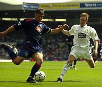 Photo Aidan Ellis.<br /> Leeds United v Portsmouth.<br /> FA Barclaycard Premiership.<br /> 25/04/2004.<br /> pompey's Arjan De Zeeuw clears from Leeds Nick Barmby