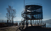 Varese, Lombardia, ITALY. General View, as the sun rises, and burns of the mist/fog at the Varese Rowing Club. [Canottieri Varese, Glass and Steel Modern styled Finish Tower,<br /> <br /> Thursday  22/12/2016<br /> <br /> [Mandatory Credit; Peter Spurrier/Intersport-images] , Atmospheric, mist, fog, Sunrise, Sunset, Blue Hour,