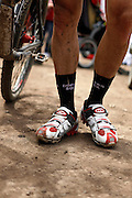 SHOT 6/5/10 1:30:47 PM - Jake Wells of Avon, Co. makes a statement with his cycling socks at the Teva Mountain Games in Vail, Co. Wells finished in 16th place in the Men's Pro division. The games attract some of the world's best extreme athletes to compete in kayaking, climbing, mountain bike racing, freeride, big air, trail and road running and dog competitions. (Photo by Marc Piscotty / © 2010)