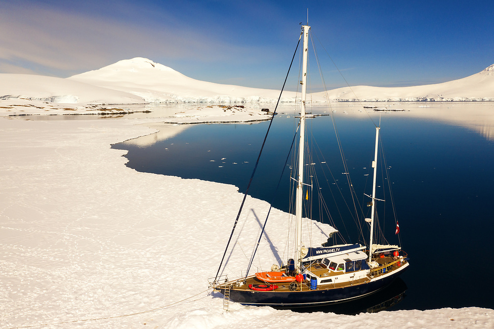 Docking / anchoring the sail boat to the sea ice near Port Lockroy, Antarctica