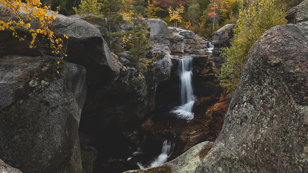 Mountain water flowing through Screw Auger Falls on a cold autumn evening.