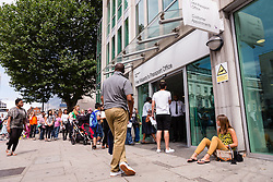 © Licensed to London News Pictures. 28/07/2014. London, UK. Queues outside the Passport Office in London. Passport workers go on a 24 hour strike in a dispute over staff numbers and pay at the British Passport Office in Eccleston Square, Victoria, London on 28th July 2014. Photo credit : Vickie Flores/LNP