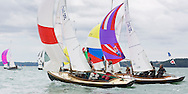 The Victory class fleet racing under spinnakers during Aberdeen Asset Management Cowes Week. <br /> Picture date Tuesday 5th August, 2014.<br /> Picture by Christopher Ison. Contact +447544 044177 chris@christopherison.com