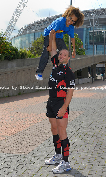 Diversity and Saracens promote Wembley Family Fun Day. Wembley, London, Britain - 18th Aug 2009..Saracens Rugby Club and England Captain Steve Borthwick and Perry Kiely, the smallest member of Diversity.