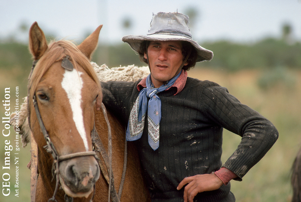 Portrait of a farmer and his horse.