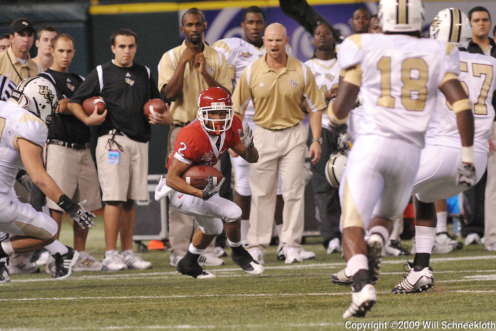 Dec 19, 2009; St. Petersburg, Fla., USA; Rutgers wide receiver Tim Brown (2) runs between defenders during NCAA Football action in Rutgers' 45-24 victory over Central Florida in the St. Petersburg Bowl at Tropicana Field.