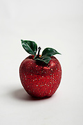 Cutout of an red apple christmas decoration on white background