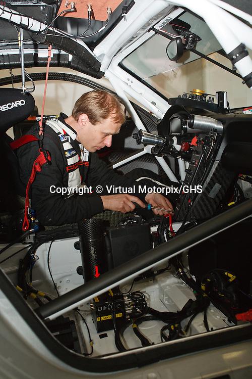 Porsche technician makes final preprations to Porsche #92 before the race at Le Mans 24H, 2013
