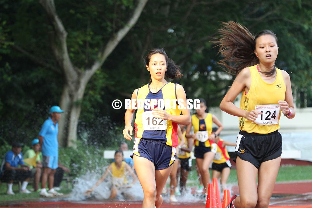 Choa Chu Kang Stadium, Friday, April 12, 2013 — Janielle Lim of Raffles Institution (RI) put in a last-minute surge on the final lap to win the A Division 2,000 metres steeplechase gold with a time of 8 minutes 7 seconds at the 54th National Schools Track and Field Championships. It was the second fastest timing clocked at the national schools championships.<br /> <br /> Story: http://www.redsports.sg/2013/04/17/a-div-2000m-steeplechase-girls-janielle-lim-ri/