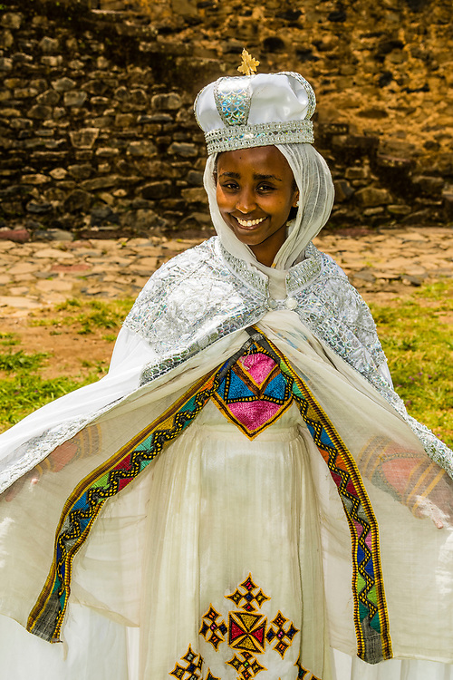 A bride having wedding photos taken at Emperor Fasilides Castle, known as the Royal Enclosure (or Fasil Ghebbi) is the remains of a fortress-city in Gondar, Ethiopia.