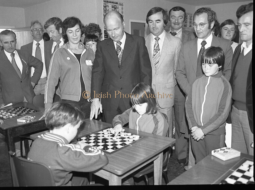 President Hillery at The Community Games..1979..15.09.1979..09.15.1979..15th September 1979..President Patrick Hillery attended the opening of The National Community Games finals at Mosney, Co Meath today. The finals were held in the grounds of The Butlins Holiday Centre and were sponsored by Tayto Irl Ltd,Greencastle Road,Coolock,Dublin..Image shows Ms Sarah Frawley,Longford,  President Hillery, Mr Kevin Masterson and Mr Joe Connally watching a draughts game between D Rendles,Kenmare,Co Kerry and Colette O'Hara, Ardagh, Co Mayo.