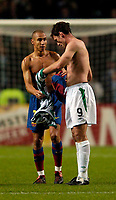 Photo. Jed Wee. Digitalsport<br /> Glasgow Celtic v FC Barcelona, UEFA Champions League, 14/09/2004.<br /> Barcelona's Henrik Larsson (L) looks to exchange shirts with Chris Sutton, as he takes a Celtic shirt for possibly the last time.