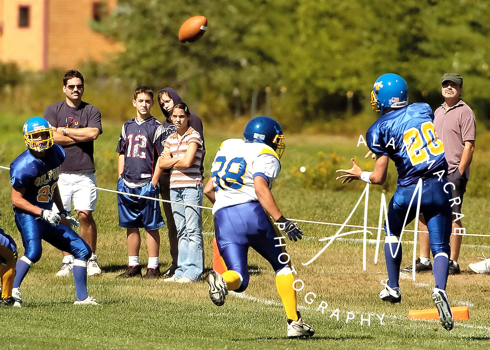 Gilford's Colby Athanas readies for an incoming pass as Franklin's Tony Huckins hopes to disrupt the play during Saturday's season opener at Gilford's Meadows Field.  (Alan MacRae/for the Citizen)
