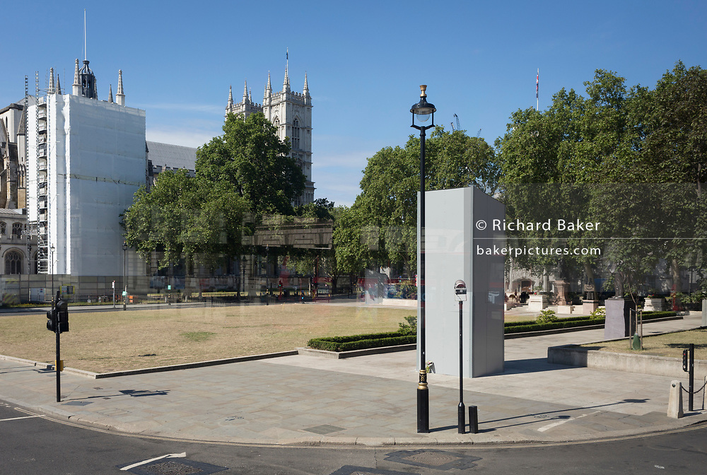 After the weekend's violence aginst police by far-right groups protesting about Black Lives Matter campaign, and especially the daubing of anti-racist graffiti on the plinth below wartime British Prime Minister the week before, Sir Winston Churchill's statue remains boarded up and boxed in a quiet Parliament Square, on 15th June 2020, in London, England.