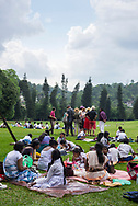 Sri Lankan school children as well as tourists enjoy the spacious grounds of the Royal Botanical Gardens in Peradeniya, located several kilometers outside the city of Kandy, Sri Lanka.