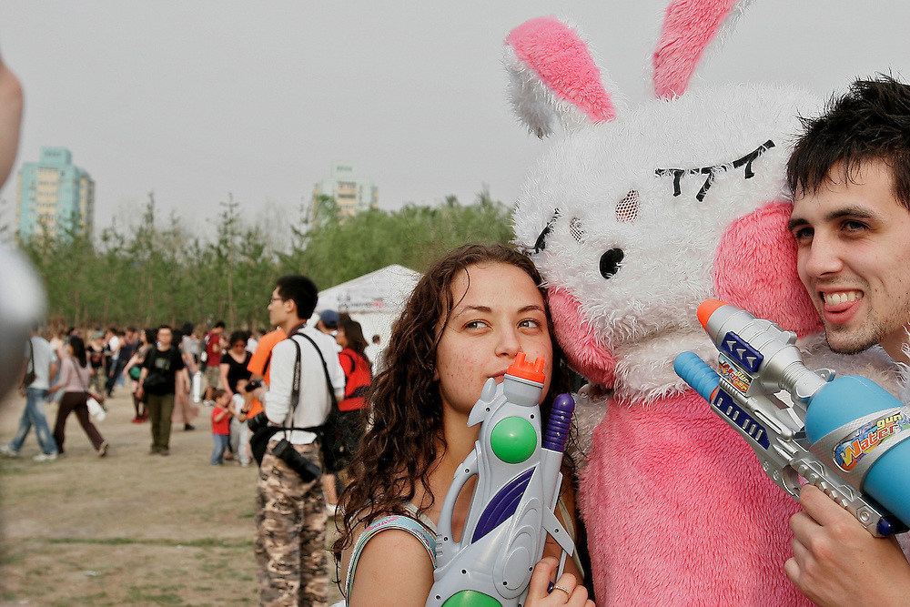Costumes and water gun fights typify the relaxed atmosphere at the Midi Festival in Beijing China 2007.  Midi is an  rock music festival held in northern Beijing catering to a small group of music listeners in China.  The festival lasts 4 days and gives performances from Chinese and international bands.