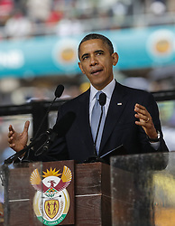 0813879<br /> U.S. President Barack Obama speaks during the memorial service for Nelson Mandela in Johannesburg, South Africa, on Dec. 10, 2013. Memorial service for former South African president Nelson Mandela started in Johannesburg on Tuesday as tens of thousands of mourners and more than 90 world leaders gather in rain to remember Mandela at memorial at the FNB Stadium in Soweto near Johannesburg, South Africa, Tuesday, 10th December 2013. Picture by  imago / i-Images<br /> <br /> UK ONLY