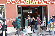 People loot a Roadrunner Sports store during a protest over the death of George Floyd, Sunday, May 31, 2020, in Santa Monica, Calif. Protests were held in U.S. cities over the death of Floyd, a black man who died after being restrained by Minneapolis police officers on May 25.