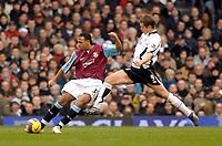 Photo: Alan Crowhurst.<br />Fulham v West Ham United. The Barclays Premiership. 23/12/2006. Heidar Helgurson of Fulham (R) challenges Anton Ferdinand for the ball.
