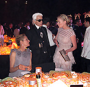 Uma Thurman, Karl Lagerfeld and Kirsten Dunst..2011 amfAR's Cinema Against AIDS Gala Inside..2011 Cannes Film Festival..Hotel Du Cap..Cap D'Antibes, France..Thursday, May 19, 2011..Photo By CelebrityVibe.com..To license this image please call (212) 410 5354; or.Email: CelebrityVibe@gmail.com ;.website: www.CelebrityVibe.com.**EXCLUSIVE**