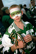 A young fan with his face painted in Celtic colours, Parkhead, Glasgow.