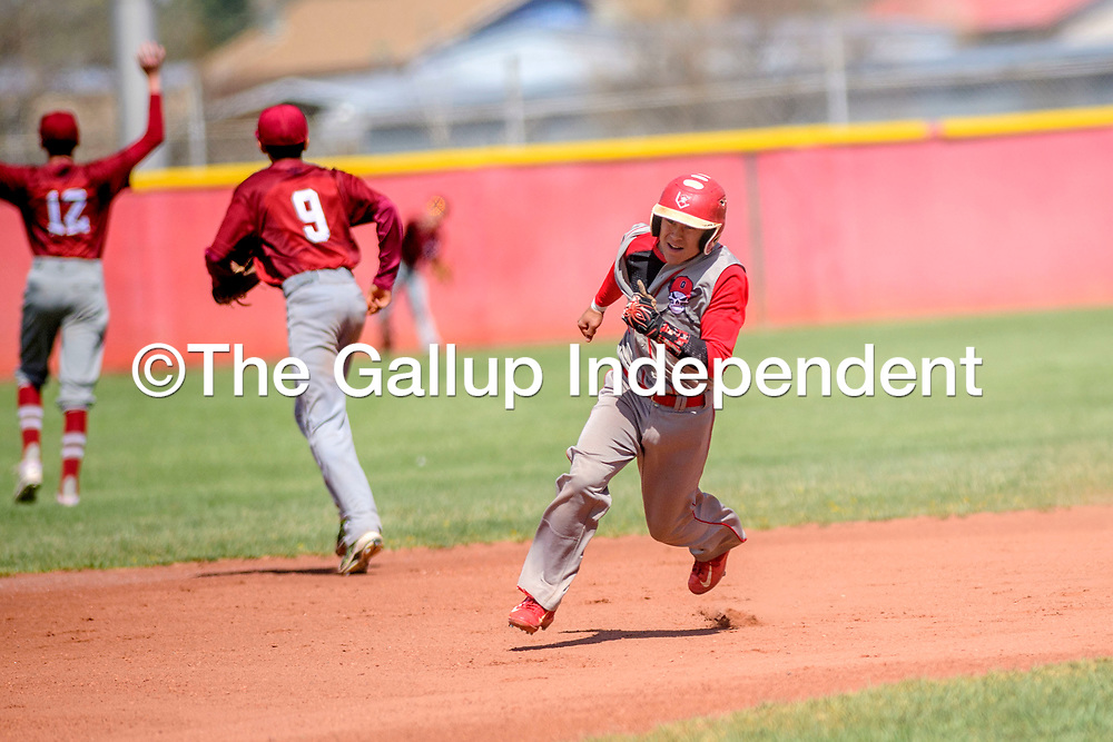 Grants Pirate Ronnie Gonzalez (3) charges past second base after a deep right-center field hit on the Sandia Prep Sundevils in Grants Tuesday.