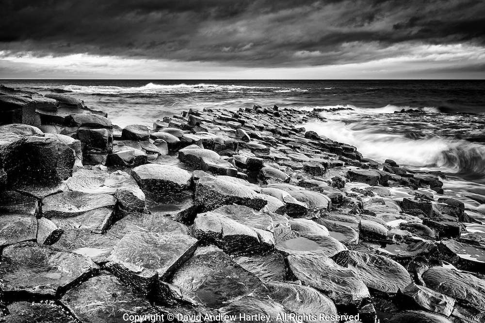 Basalt columns of the Giants Causeway made wet by the Irish sea and a passing storm, County Antrim, Northern Ireland