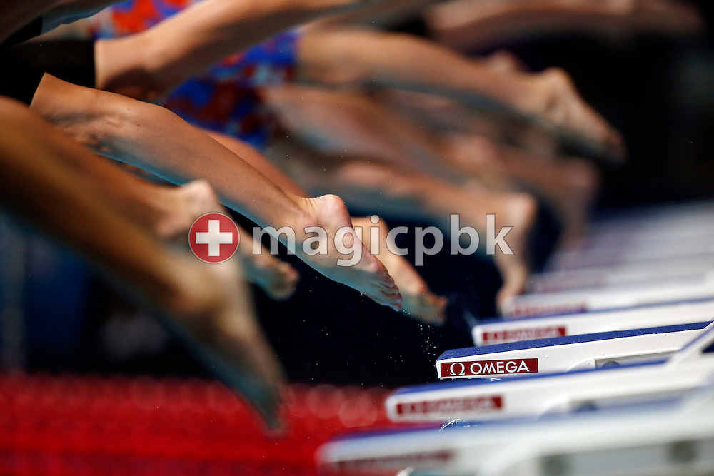 Swimmers dive of the starting blocks in the men's 800m Freestyle Heat 4 during the 15th FINA World Aquatics Championships at the Palau Sant Jordi in Barcelona, Spain, Tuesday, July 30, 2013. (Photo by Patrick B. Kraemer / MAGICPBK)