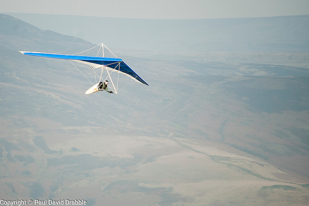 Hang glider launched from Mam Tor also known as Mother Hill or shivering Mountain near Castleton in the High Peak of Derbyshire, England..www.pauldaviddrabble.co.uk.15 January 2012.Image © Paul David Drabble