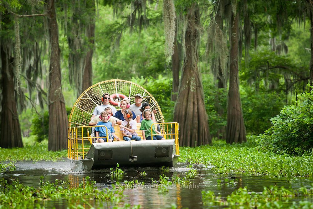 Tourists ride an airboat through the cypress forest of Henderson Swamp with the help of tour guide and airboat captian Byron Lemaire from McGee's Atchafalaya Basin Swamp Tours in Henderson, La.