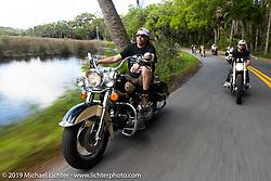 Ray-Ray riding Jay Allen's Shovelhead through Tomoka State Park during Daytona Bike Week. FL. USA. Sunday March 18, 2018. Photography ©2018 Michael Lichter.