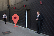 Large scale Google 'you are here' pin outside a PR event in London, UK.