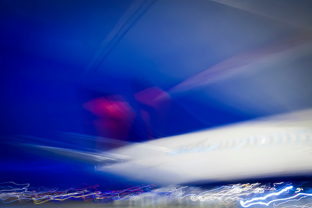 A 4 second exposure rendered this Delta Air Lines Boeing 767-332(ER)(WL) as an abstract study of light and shape, at Atlanta's Hartsfield-Jackson International Airport.  <br />