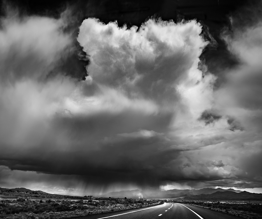 When it rains in Death Valley, CA, it is very specific and often seen far away.  Driving into the storm is an energizing experience of nature.  Both you and the storm are moving.