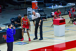 NORMAL, IL - February 27: Brian Jones has a few last words with Emon Washington at the check in table with Ben Jacobson standing not far away during a college basketball game between the ISU Redbirds and the Northern Iowa Panthers on February 27 2021 at Redbird Arena in Normal, IL. (Photo by Alan Look)