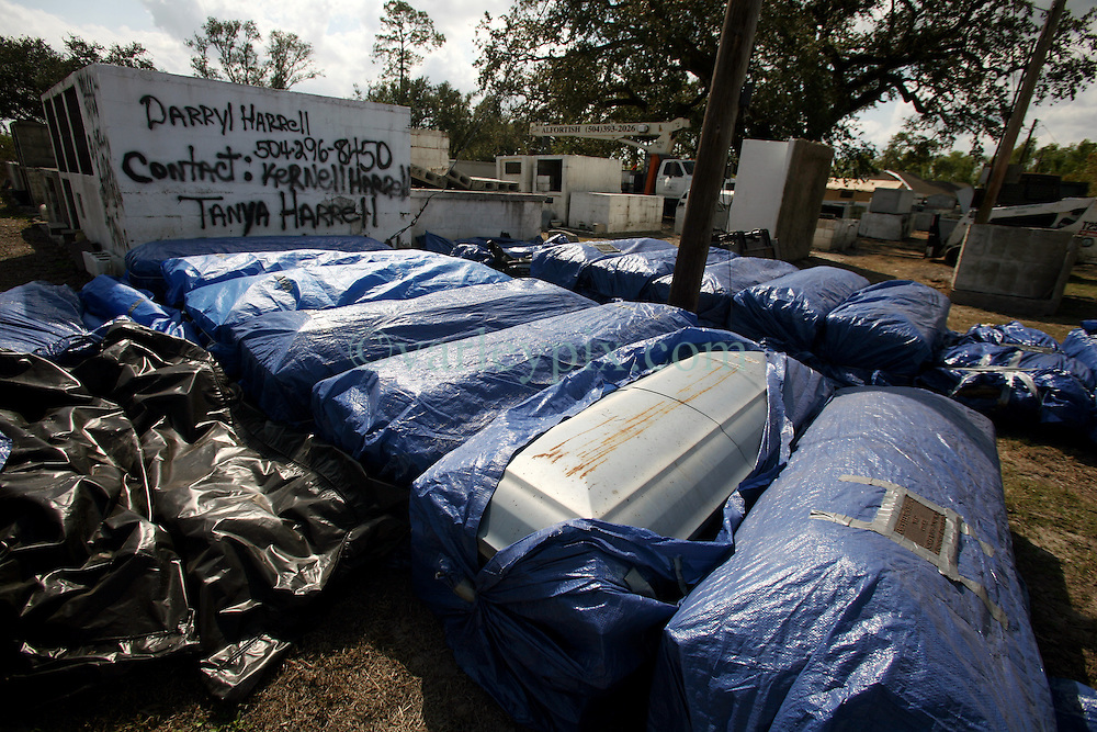 26 September 2012. Braithwaite, Plaquemines Parish, Louisiana,  USA. .Coffins and human remains are collected by the Disaster Mortuary Operational Response Team (DMORT) at Promise Land Cemetery off highway 39. Tombs were washed from the cemetery during Hurricane Isaac..Photo; Charlie Varley.
