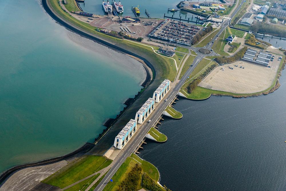 Nederland, Friesland, Groningen, Lauwersoog, 04-11-2018; Lauwersmeer op de grens van Groningen en Friesland, afsluitdijk van de Lauwerszee. In de dijk spuisluizen naar Waddenzee, de R.J. Cleveringsluizen. Naast deze sluizen de schutsluis, de Robbengatsluis.<br /> Lauwersmeer on the border between Groningen and Friesland, the dike of the Lauwers sea.<br /> luchtfoto (toeslag op standaard tarieven);<br /> aerial photo (additional fee required);<br /> copyright © foto/photo Siebe Swart
