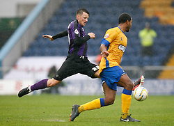 Bristol Rovers' Ollie Clarke chalenges Mansfield Town's Kieran Murtagh - Photo mandatory by-line: Matt Bunn/JMP - Tel: Mobile: 07966 386802 12/10/2013 - SPORT - FOOTBALL - Field Mill - Mansfield - Mansfield Town V Bristol Rovers - Sky Bet League 2