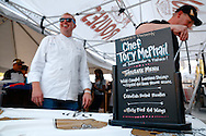 Commanders Palace Chef Tory McPhail cooks at a tailgate at Rouses Markets in New Orleans, LA.