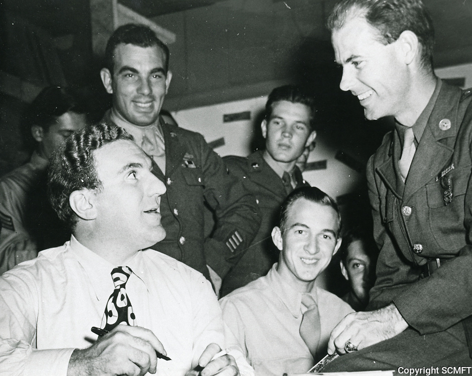 1944 Actor William Bendix signs autographs for servicemen at the Hollywood Canteen.