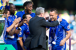 Retiring captain John Terry is presented with his winners medal by Premier League Executive Chairman Richard Scudamore as Chelsea celebrate winning the 2016/17 Premier League - Rogan Thomson/JMP - 21/05/2017 - FOOTBALL - Stamford Bridge - London, England - Chelsea v Sunderland - Premier League..