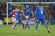 AFC Wimbledon attacker Shane McLoughlin (19) battles for possession during the The FA Cup match between AFC Wimbledon and Doncaster Rovers at the Cherry Red Records Stadium, Kingston, England on 9 November 2019.