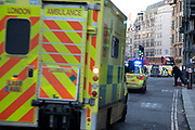 Ambulances arrive as the City of London is locked down by Metropolitan and City Police following what is believed to have been a terror-related incident on London Bridge at around 2pm on 29th November 2019 in London, United Kingdom. Police officers cordoned off the bridge, underpass and all surrounding roads following the incident during which members of the public intervened before shots were fired by armed police. The incident is said to have started as a stabbing during which a number of people were stabbed in a building near London Bridge.