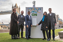 © Licensed to London News Pictures. 13/01/2020. LONDON, UK.  London, UK.  13 January 2020.  Sadiq Khan, Mayor of London (C), Shirley Rodrigues, Deputy Mayor for Environment and Energy (2R), and Stuart Jackson, CEO of Octopus Energy (R), at the switch-on of a giant lightbulb in front of Tower Bridge to mark the launch of a brand new fair-priced, green energy company, available exclusively to Londoners to cut fuel bills and help make the capital a zero carbon city.    Photo credit: Stephen Chung/LNP