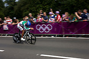 Iranian Alireza Haghi races past fans lining the route through Bushy Park in south west London, during the London 2012 Olympic 44km men's cycling time trial, eventually won by Team GB's Bradley Wiggins.
