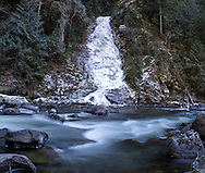 Eureka Falls is frozen nearly solid during a cold winter in Hope, British Columbia, Canada