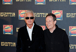 © Licensed to London News Pictures. 12/10/2012. London, UK.  Led Zeppelin guitarist Jimmy Page (left) and bassist John Paul Jones (right) at the cinema premiere of Celebration Day, the recording of their 2007 live show held at the O2 Arena, screened at the Hammersmith Apollo.  Photo credit : Richard Isaac/LNP