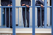 Young offenders hang outside their cells on K wing of the YOI. HMP & YOI Littlehey. Littlehey is a purpose build category C prison.